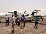 Journalists and aid workers prepare to board a plane in Niger.jpg