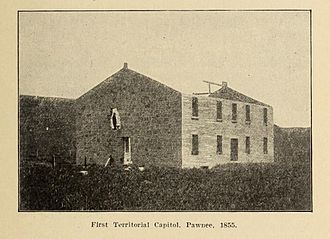 First Territorial Capitol of Kansas - Under construction, still roofless and with a maintenance opening in the west end, 1855
