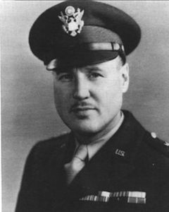 Head and shoulders of a man in uniform with a peaked cap