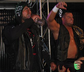 NWA World Tag Team Championship - Lance Archer (left) and Davey Boy Smith Jr. (right), held both the NWA and IWGP Tag Team Championship at the same time.