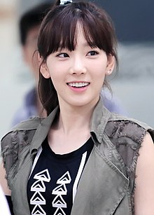 Kim Taeyeon at Gimpo Airport, 30 June 2014.jpg