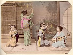 Japanese traditional dance - An early photograph of Japanese women in dance pose.