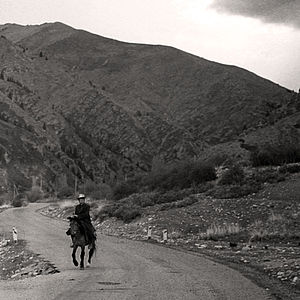 History of Kyrgyzstan - Man on horse in Kyrgyzstan (1995)