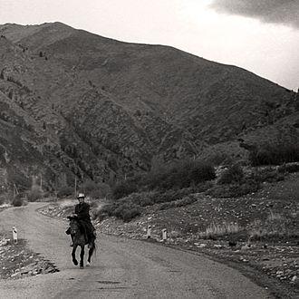 History of Kyrgyzstan - Man on horse in Kyrgyzstan (1995)