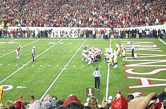 2010 Arkansas Razorbacks football team - Mallett kneels down on the one-yard line to finish the game. The win is the Hogs' third in four years against their rivals.
