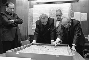 Walt Whitman Rostow showing President Lyndon B. Johnson a model of the Khe Sanh area in February 1968