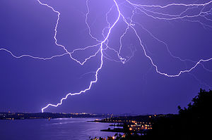 English: Lightning over St-Laurent River by a ...