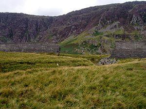 Llyn Eigiau - The breach in the dam, showing the gully cut by floodwater.