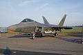 Lockheed-Martin F-22A-30-LM Raptor 05-099 LSideFront Dawn SNF 04April2014 (14399750798).jpg