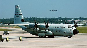 Lockheed WC-130 - WC-130J on the ramp at Dobbins Air Reserve Base during Hurricane Katrina, 2005. A second WC-130J is landing in the background. The 53d WRS was displaced by severe storm damage to its base at Keesler AFB, Mississippi.