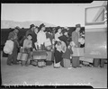 Lone Pine, California. Evacuees of Japanese ancestry arrive here by train and await buses for Manza . . . - NARA - 536231.tif
