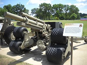 M101 howitzer - The only surviving prototype M2A2 Terra Star Auxiliary Propelled Howitzer at the Rock Island Arsenal Museum. Note the tri-star wheel system and auxiliary drive system on the right trail leg.