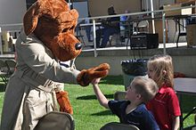 McGruff, left, high-fives two children at right