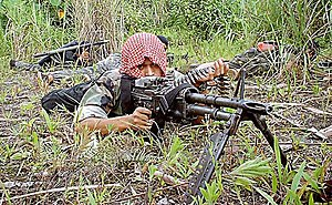 Moro Islamic Liberation Front - A Bangsamoro fighter trains with an M60 machine gun.