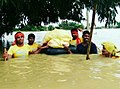 MSU Senani carrying relief item for flood affected victims.jpg