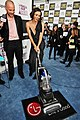 Maggie Gyllenhaal with the LG Electronics Kompressor Vacuum on 25th Spirit Awards Blue Carpet held at Nokia Theatre L.A. Live on March 5, 2010 in LA.jpg