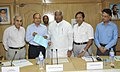 Mallikarjun Kharge receiving two cheques of total amount of Rs.57,14000- from the Chairman cum Managing Director, RailTel, Shri R.K. Bahuguna, towards Prime Minister's National Relief Fund for Uttarakhand flood victims.jpg