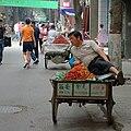 Man is selling fruits in the street.jpg