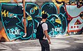 Man looks at graffiti (Unsplash).jpg