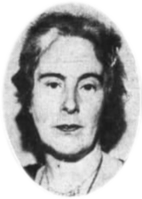 A black and white photograph of a woman's head