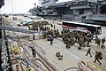 Marines board the amphibious assault ship USS Iwo Jima (LHD 7). (30122949812).jpg