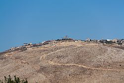 The village of Maroun al-Ras, as seen from the Israeli side of the border, near Avivim