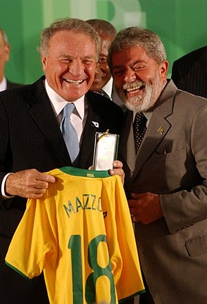 José Altafini - Altafini being presented with a commemorative jersey by the President of Brazil on the 50th anniversary of the nation's victory in the 1958 FIFA World Cup