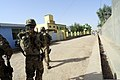 Members of the Farah Provincial Reconstruction Team (PRT) approach the Farah chief justice compound in Farah, Afghanistan, Aug. 29, 2012 120829-N-II659-0756.jpg