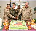 Michael Bumgarner helps cut a cake.jpg