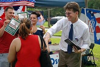 Michael E. Arth - Michael E. Arth shaking hands with supporter.