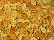 A mosaica pattern composed of components having various shapes and shades of brown .