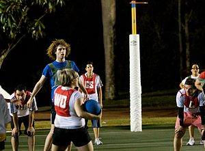 Netball - Men and women play together during a mixed netball game in Australia.