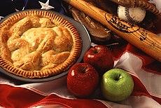 Iconos de la cultura estadounidense, tarta de manzana, bate de béisbol y su bandera.