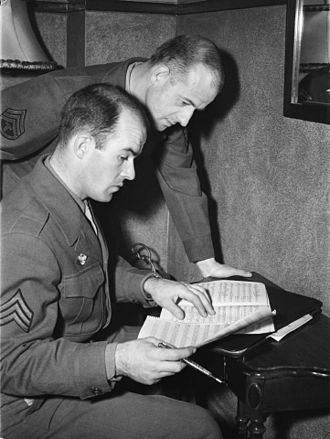 Rupert von Trapp - Rupert von Trapp, standing, on the side of his younger brother, Werner, sitting, both wearing a uniform and reading a partition on 24 January 1946