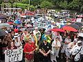 NOLA BP Oil Flood Protest brollys musicians Spike.JPG