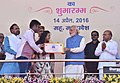 """Narendra Modi presenting the credit certificates, under various schemes to the beneficiaries from Scheduled Casts, at the launching ceremony of the """"Gram Uday se Bharat Uday"""" Abhiyan, in Mhow, Madhya Pradesh (3).jpg"""