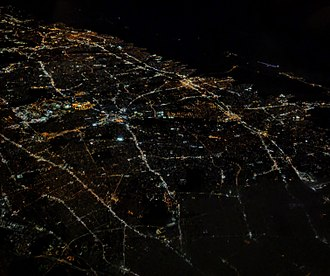 Nassau County, New York - Nighttime aerial view of much of Nassau County, from the west-northwest; Hempstead is in the center, with roads projecting out in various directions; bridges to Jones Beach Island are at the upper right.  The Grand Central Parkway–Cross Island Parkway interchange, barely visible at the lower left, is just outside the county, within Queens.