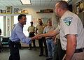 Nevada Governor Brian Sandoval greets Dylan Rader, acting Fire Management Officer, (7782462392).jpg
