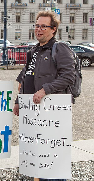 Bowling Green massacre - Man holding satirical sign at protest in San Francisco, February 2017