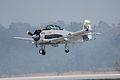 North American T-28C Trojan Sherry Berry Landing 03 TICO 13March2010 (14412899488).jpg