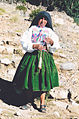 Old female with drop spindle on Taquile island Peru.jpg