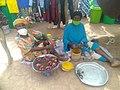 Old women selling cola nut at Funsi in the Upper West Region of Ghana.jpg