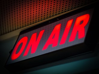 Broadcasting - On Air sign illuminated usually in red while recording or broadcasting
