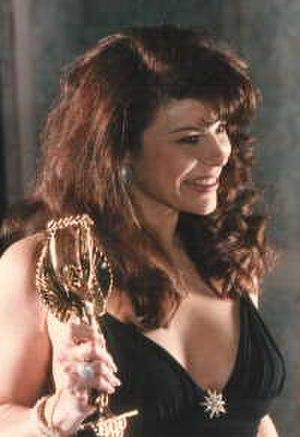 Ona Zee - Ona Zee holding an AVN Award
