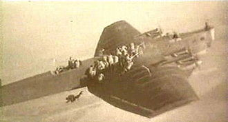 Russian Airborne Troops - Soviet Paratroopers deploy from a Tupolev TB-3 in 1930.