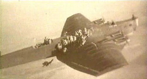 Paratroopers jumping from Tupolev TB-3