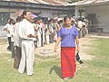 People waiting in a queue to cast their votes at a polling booth No. 29 of West Khamang district of Arunachal Pradesh on May 5, 2004.jpg
