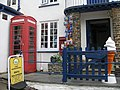 Phonebox, postbox and fake ice cream, Clovelly - geograph.org.uk - 1318544.jpg