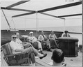 Photograph of President Truman and others sunning themselves on the after deck of his yacht, the U.S.S. WILLIAMSBURG... - NARA - 199030.tif
