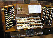 The console of a pipe organ (musical instrument).